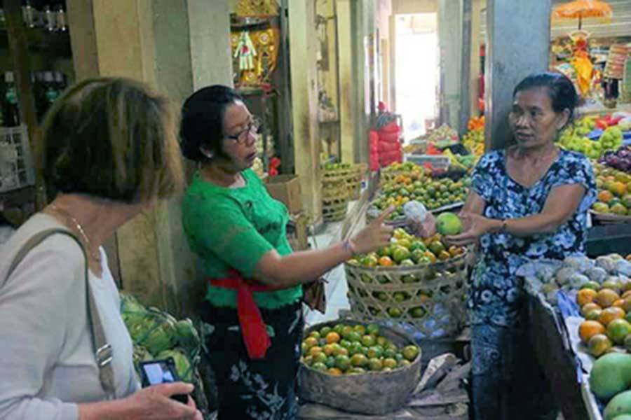 visiting the traditional market, sightseeing, mambal